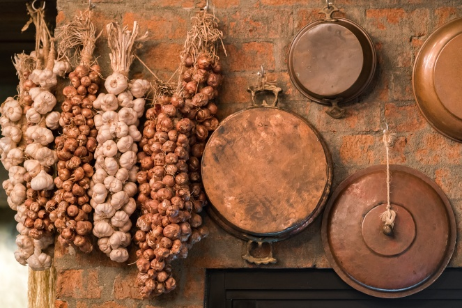 Old, vintage kitchenware against brick  wall